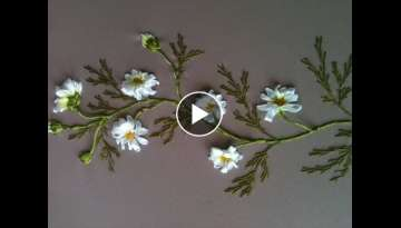 Embroidery of chamomile leaves