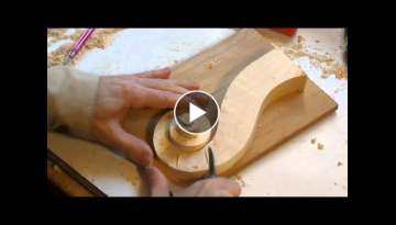 Carving a violin scroll